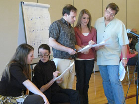 Discussing possible changes mid-rehearsal at the Composers' Workshop 2011: Composer Lauren McLaren, Teaching Artist Libby Larsen, Artistic Director Martín Benvenuto, and directors of collaborating high school choirs Sarah Downs(Miramonte HS) and Bruce Lengacher (Acalanes HS).